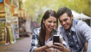Happy Couple Using Social Media